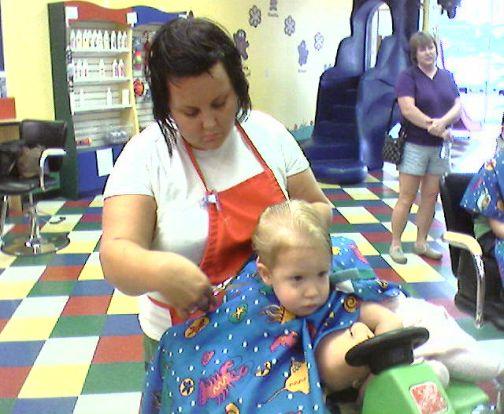 ashton's first haircut
